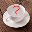 Empty white cup with red question mark in it. — Stock Photo