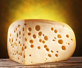 Quarter of Emmental cheese head. — Stock Photo