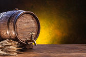 Old oak barrel on a wooden table. — Stock Photo