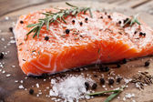 Salmon filet on a wooden carving board. — Stock Photo