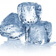 Three ice cubes on white background. — Stockfoto