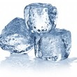 Three ice cubes on white background. — Foto de Stock