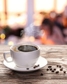 Cup of hot coffee on a old wooden table. — Stock Photo