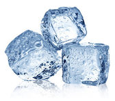 Three ice cubes on white background. — Stock Photo