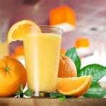 Orange fruits and glass of orange juice. — Stock Photo #51169477