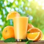 Orange fruits and glass of orange juice. — Stock Photo #51169487