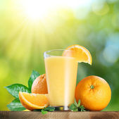 Orange fruits and glass of orange juice. — Stock Photo