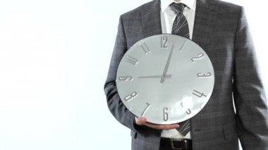 Businessman holding a clock — Stock Video