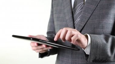 Business man touching tablet pc sensitive screen — Stock Video