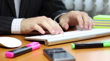 Manager Typing on a white keyboard — Stock Video
