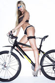 Sexy lady with bicycle — Stock Photo