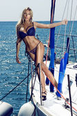 Woman in swimsuit posing on yacht — Stock Photo