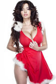 Brunette in Santa Claus peignoir — Stock Photo