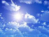 Blue Sky with Sun and Clouds — Stock Photo