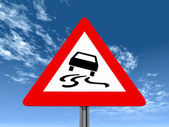 Road slippery when wet or dirty — Stock Photo
