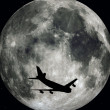 Stock Photo: Airliner and Moon