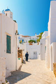 Orthodox priest in Sifnos alleyway — Stock Photo