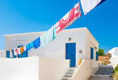 Laundry line outside Greek island house — Stock Photo