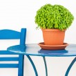Blue chair and table with basil flowerpot — Stock Photo #13152141