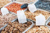 Market stand selling variety of dried fruit — Stock Photo