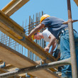 construction workers placing formwork beams — Stock Photo