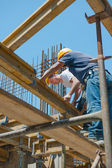 Construction workers placing formwork beams — Photo