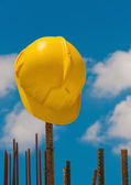 Construction helmet on steel bars — Stock Photo
