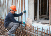 Construction worker cutting steel rods — Stock Photo