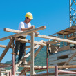 Construction worker on scaffold - Stock Photo