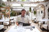 Man in restaurant — Stock Photo
