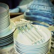 Forks on plates - Stock Photo