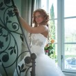 Bride on stair in house — Stock Photo
