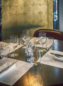 Table in modern restaurant — Stock Photo