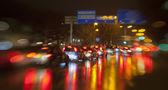Traffic light in rain city — Stock Photo