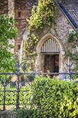 Garden by old English church  — Stock Photo