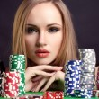 Royalty-Free Stock Photo: Sexy woman with game chips