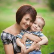 Happy little boy in the park with mother — Stock Photo #13291665