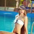 Sexy women in pool — Stock Photo #13291866