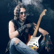 Постер, плакат: Rocker with an electric guitar