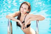 Sexy women in pool — Stock Photo