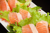 Japanese raw fish with vegetables — Stock Photo