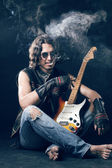 Rocker with an electric guitar — Stock Photo