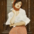 Stock Photo: Beautiful young girl in retro style
