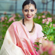 Beautiful indian girl in the indian national dress on greenhouse — Stock Photo #13805347