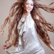 Stock Photo: Closeup portrait of glamour young girl with beautiful long hair