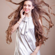 Closeup portrait of glamour young girl with beautiful long hair — Stock Photo #13805510