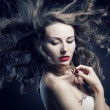 Closeup portrait of glamour young girl with beautiful long hair — Stock Photo #13805530
