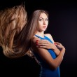 Closeup portrait of glamour young girl with beautiful long hair — Stock Photo #17886751