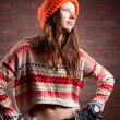 Beautiful young girl in a sweater and cap color — Stock Photo