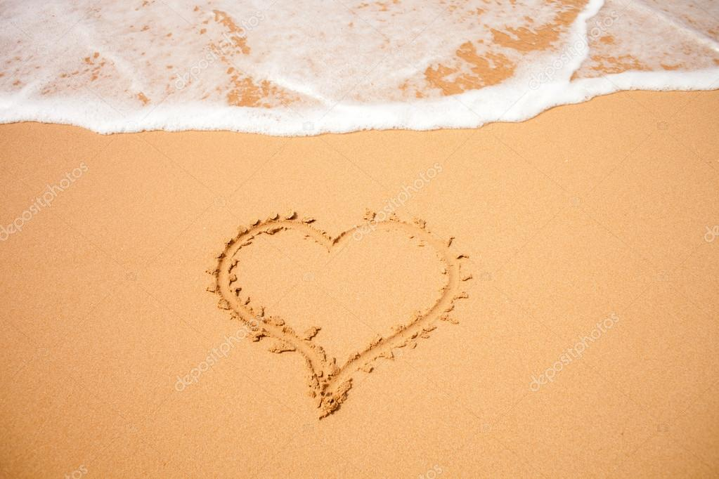 Heart on the sand — Stock Photo #17886963